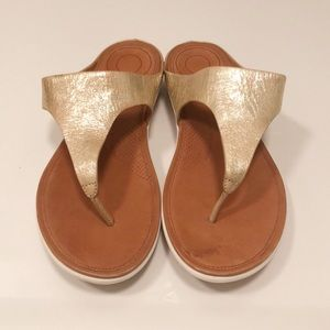 Fitflop gold sandals with white sole
